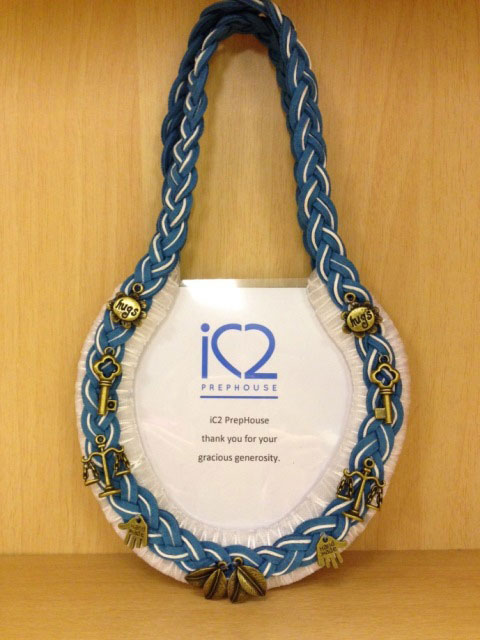 A horseshoe photo frame designed by iC2 for Jurong point Horseshoe Charity auction