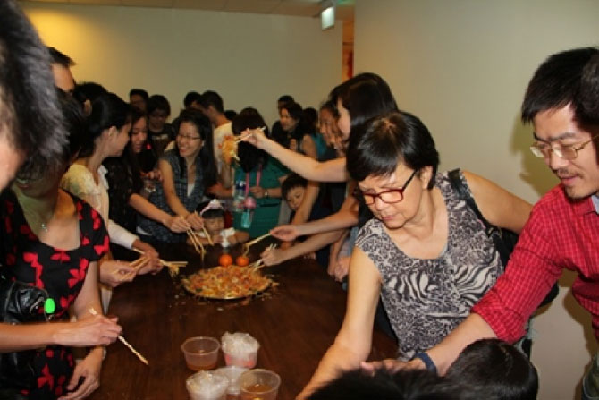 The Management and Staff with parents and students gathered together to 'Lo Hei' for happy and prosperous year of the horse