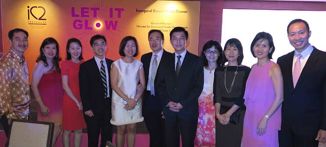 Group photo made up of iC2 directors with Minister Tan Chuan Jin.