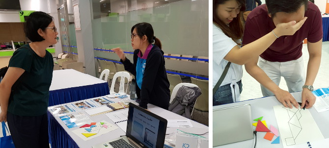 SNEC 18th National Eye Care Day - iC2 teacher Wai Ling attending to visitors to the booth