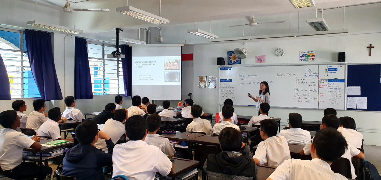 In the classroom, Teacher Amanda sharing with the classmates of our student's visual impairment and how they can support him in school.